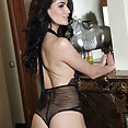 Exotic goddess in black bodysuit showing shaved pussy - image 2