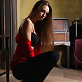 Cute brunette in red blouse exposes firm large breasts - image 2