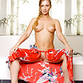 Juicy blond reveals her soft breasts and fresh labia in this indoor shoot - image 2