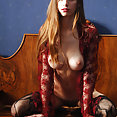 Thin brunette with sheer top and stockings spreads out for the journey - image 2