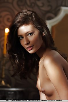 Elegantly beautiful maiden with subtly erotic sensual poses on top of the bed