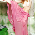 Unique model with kinky blonde hair just as she gets out of the shower - image 2