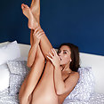 Sabrisse A Shows her Yummy pussy as she strips on the bed - image 2