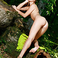 Gracia flaunts her sexy slender body and smooth pussy in the woods - image 2