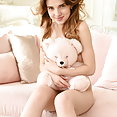 Best model Caramel bares her amazing body as she poses on the couch - image 2