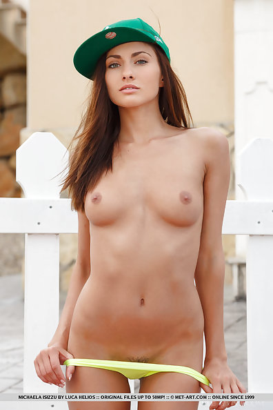 Michaela Isizzu gets naked outdoors and  shows her smoking hot body and trimmed pussy